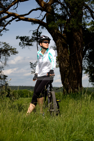 Cycling woman stock photo, A cycling woman taking a break by Val Thoermer