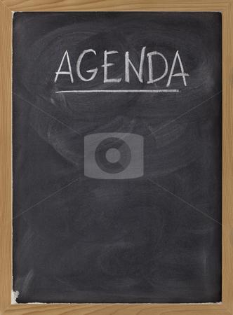 Agenda - blank blackboard sign stock photo, Agenda - white chalk handwriting on blackboard with eraser smudges texture, copy space below by Marek Uliasz