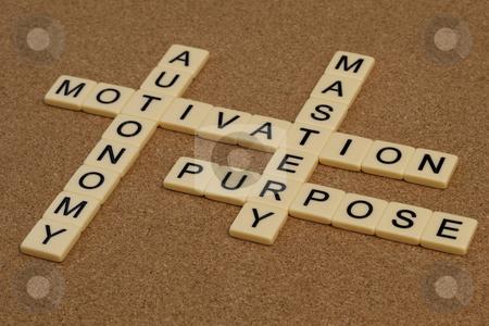 Mastery, autonomy, purpose, motivation stock photo, Three elements of true motivation - mastery, autonomy, purpose - crossword with ivory letter blocks on cork board by Marek Uliasz