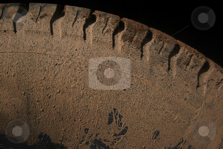 Muddy tire stock photo, Car tire covered in dirt and mud after driving offroads by Jon Helgason