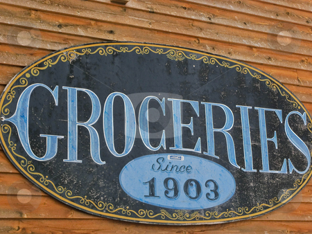 Old grocery sign stock photo, An old grocery store sign on a building by Jan Nickelson