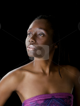 Portrait of young black woman against dark background stock photo, Bare Shoulder portrait of African American Woman by Jeff Cleveland