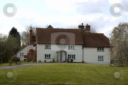Country house  stock photo, A large white house in the countryside by Mark Bond