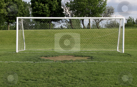 Wide Open Soccer Net stock photo, A view of a net on a vacant soccer pitch. by Chris Hill