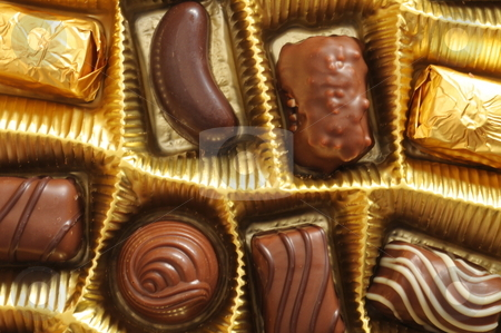Chocolate truffles in a box stock photo, Chocolate truffles in a golden gift or present box by Gunnar Pippel