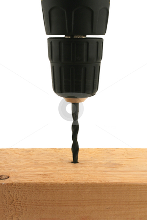Cordless drill drilling into wood stock photo, A isolated Cordless drill drilling into wood by Jim Mills