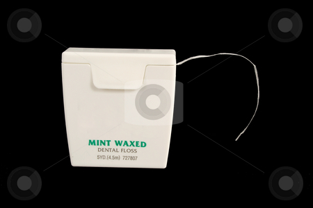 Dental floss on black background stock photo, Dental floss on black background by Jim Mills