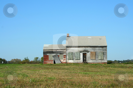 Old abandoned house stock photo, An Old abandoned house with grass and sky by Jim Mills