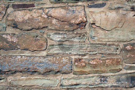 Old rock building wall stock photo, An Old rock building wall abstract background by Jim Mills