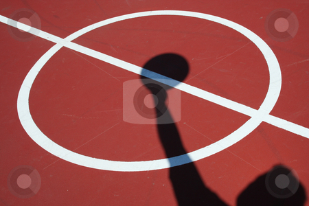 Shadow Basketball player jump ball stock photo, A Shadow Basketball player jump ball on red court by Jim Mills