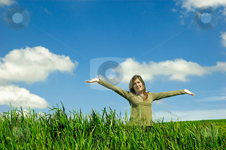 Happy woman stock photo, Happy young with open arm in the field by ikostudio
