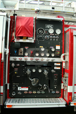 Fire Truck controls stock photo, A Fire Truck controls parked outside a firehouse by Jim Mills