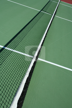 Tennis court net stock photo, A long view of a Tennis court net by Jim Mills