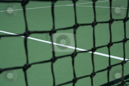 Tennis Court Net  stock photo, Tennis Court Net focus on the court by Jim Mills