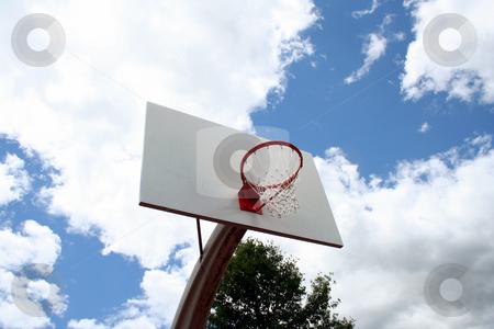 Basketball hoop against sky stock photo, An image of a Basketball hoop against a cloudy sky by Jim Mills