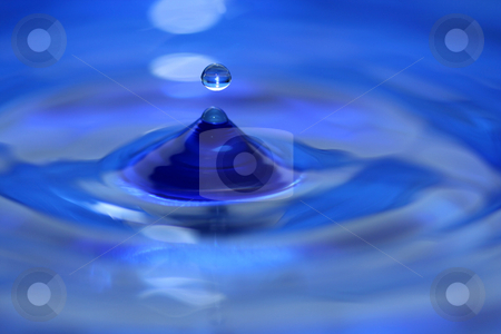 Water droplet splash stock photo, A blue water droplet splashing by Jim Mills