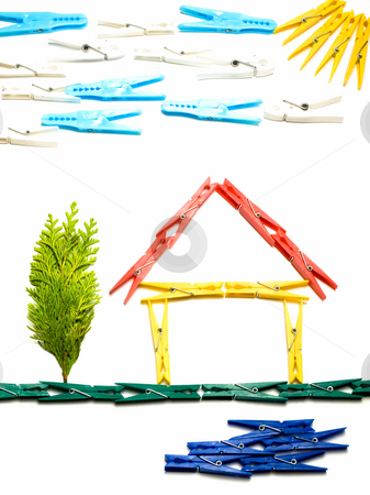 Domestic home stock photo, House and surrounding  outline made from colored clothes pegs, like children's drawings. by Sinisa Botas