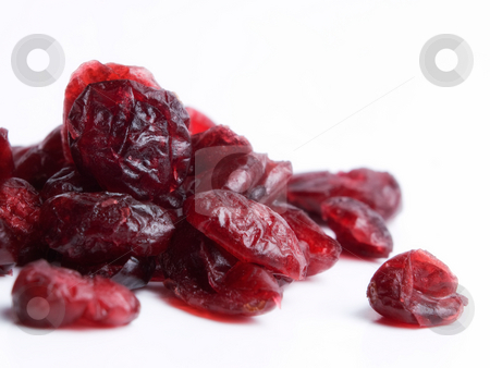 Dried cranberries stock photo, Macro of dried cranberries on a white background. by Sinisa Botas