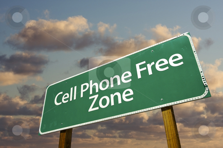 Cell Phone Free Zone Green Road Sign and Clouds stock photo, Cell Phone Free Zone Green Road Sign In Front of Dramatic Clouds and Sky. by Andy Dean