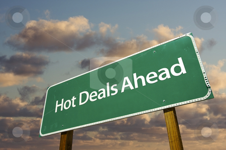 Hot Deals Ahead Green Road Sign Over Clouds stock photo, Hot Deals Ahead Green Road Sign Over Dramatic Clouds and Sky. by Andy Dean