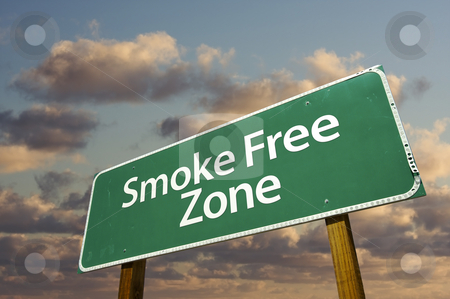 Smoke Free Zone Green Road Sign and Clouds stock photo, Smoke Free Zone Green Road Sign In Front of Dramatic Clouds and Sky. by Andy Dean