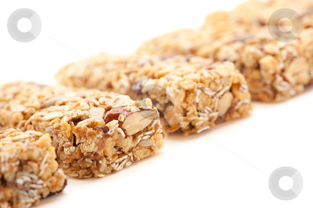 Row of Several Granola Bars Isolated on White stock photo, Row of Several Granola Bars Isolated on a White Background with Narrow Depth of Field. by Andy Dean