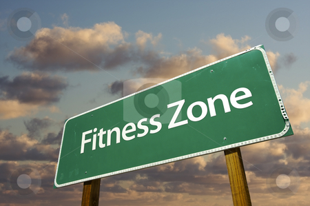 Fitness Zone Green Road Sign and Clouds stock photo, Fitness Zone Green Road Sign In Front of Dramatic Clouds and Sky. by Andy Dean