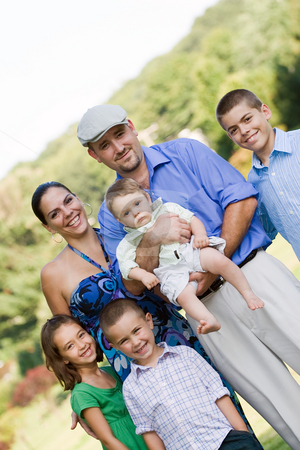 Happy Smiling Family stock photo, Portrait of an nice looking family with four children and one baby. by Todd Arena