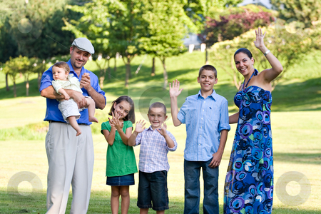Happy Waving Family stock photo, Portrait of an attractive young family with four children waving happily. by Todd Arena