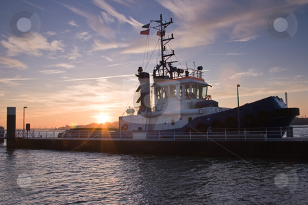Tugship in port stock photo, Tug at sunrise just before leaving port by Colette Planken-Kooij