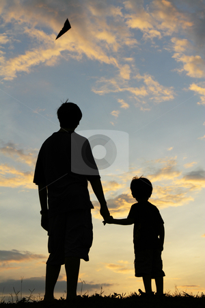 Father and son stock photo, Silhouette of a father and his son watching a kite fly in the sky during sunset by Adrin Shamsudin