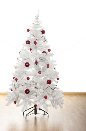 Christmas tree stock photo, Christmas white tree with red ornaments in a house by ikostudio