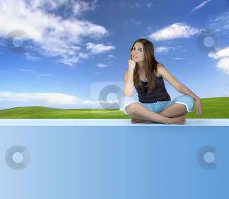 Athletic woman stock photo, Beautiful athletic woman with different poses seated on a green wall by ikostudio