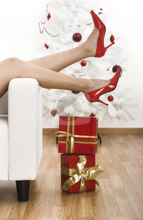 Red Shoes stock photo, Sexy woman legs with red shoes on a Christmas environment by ikostudio