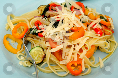 Fettucini And Sweet Peppers stock photo, Fettucini with vegetables saut?ed in olive oil with sweet peppers, sliced zucchini squash with grated parmesan cheese by Lynn Bendickson