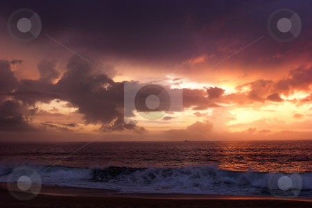 Wonderful day stock photo, Sunset on the beach with a great beautiful sky by ikostudio