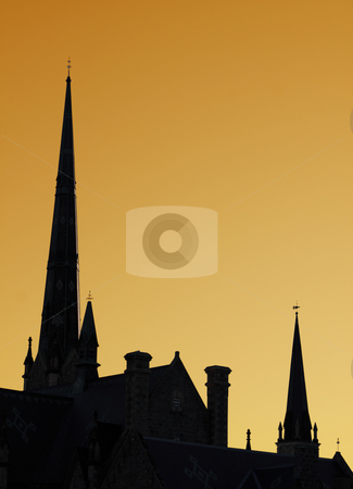 Church Steeples stock photo, The spires of a cathedral against an orange sky. by Chris Hill