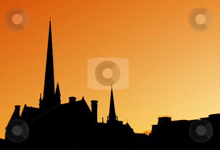 Cathedral Spires stock photo, The spires of a cathedral against an orange sky. by Chris Hill