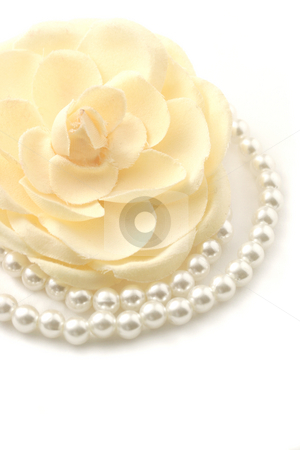Pearls and flower stock photo, Macro shot of a beautiful flower and pearl necklace isolated on white. by Claudiu Badea