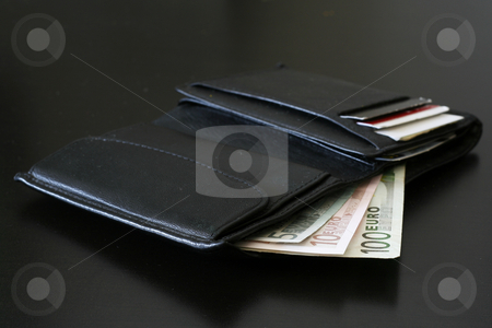 Money stock photo, Euro bills coming out of a black wallet. by Claudiu Badea