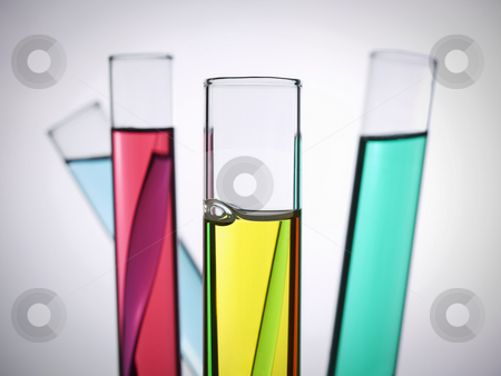 Test tubes stock photo, Four test tubes filled with colored liquids. by Ignacio Gonzalez Prado