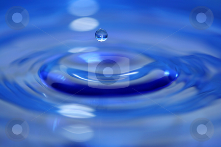 Water droplet stock photo, A Blue water droplet falling by Jim Mills