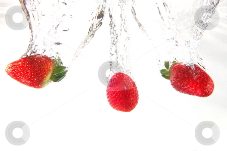 Strawberry splash stock photo, Strawberry splash in water showing a fitness concept by Gunnar Pippel