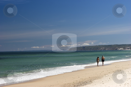 White Sand Beach stock photo, Couple walking on the white sand in a beautiful beach by ikostudio