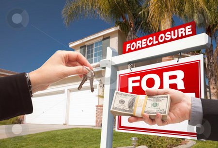 Handing Over Cash For House Keys stock photo, Handing Over Cash For House Keys in Front of House and Foreclosure Sign by Andy Dean