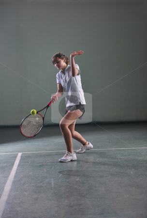 Tennis girl stock photo, Young girl exercise tennis sport indoor by Benis Arapovic