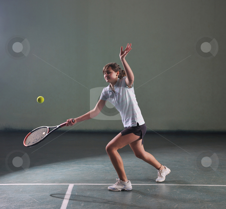 Tennis girl stock photo, Young girl exercise tennis sport indoor by Benis Arapovic