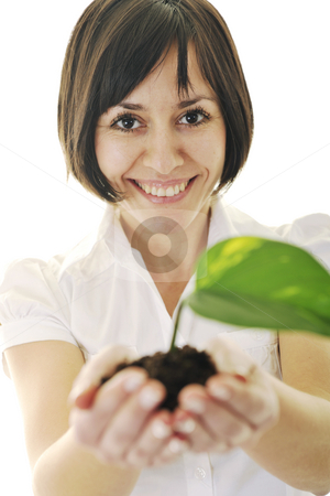 Green vision stock photo, Young business woman isolated on white holding green plant with small leaf and waiting to grow by Benis Arapovic