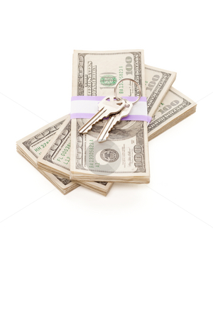 House Keys on Stack of Money Isolated stock photo, House Keys on Stack of Money Isolated on a White Background - Cash for Keys Program. by Andy Dean