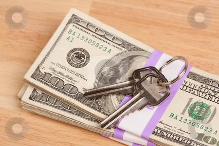 House Keys on Stack of Money stock photo, House Keys on Stack of Money - Cash for Keys Program. by Andy Dean
